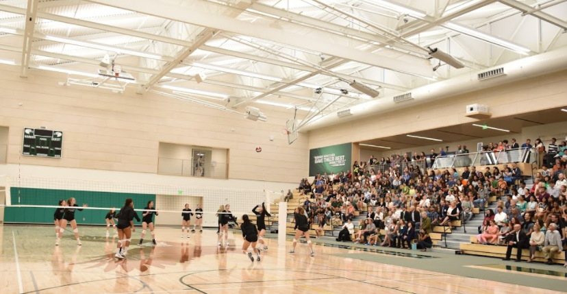 The+varsity+girls+volleyball+team+was+the+first+Harker+sports+team+to+hold+a+sporting+event+in+the+new+gym.+The+teams+scrimmage+was+part+of+the+centers+opening+ceremony+on+Aug.+18.