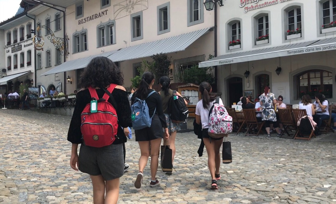 Students and their buddies walk to lunch on the streets of Bern, the capital of Switzerland. I think for a lot of Harker students, it was quite an interesting experience of being more independent and free, chaperone Galina Tchourilova said.
