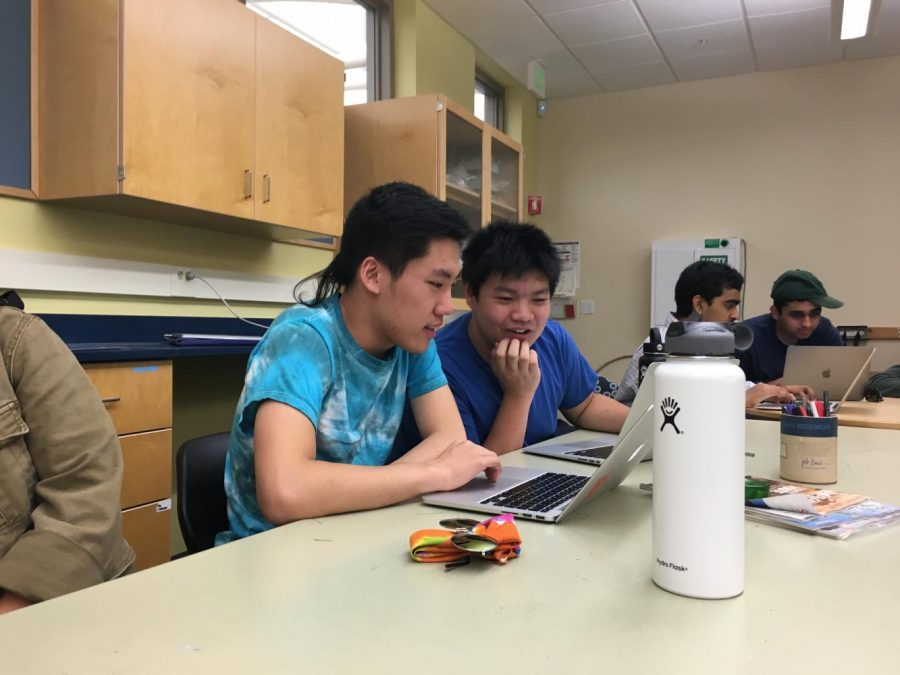 Justin Xie (12) and Michael Kwan (12) work on their research paper during the Advanced Research Class. Students submitting papers to the Siemens Competition had until Sept. 25, a six-day extension from the previous deadline.