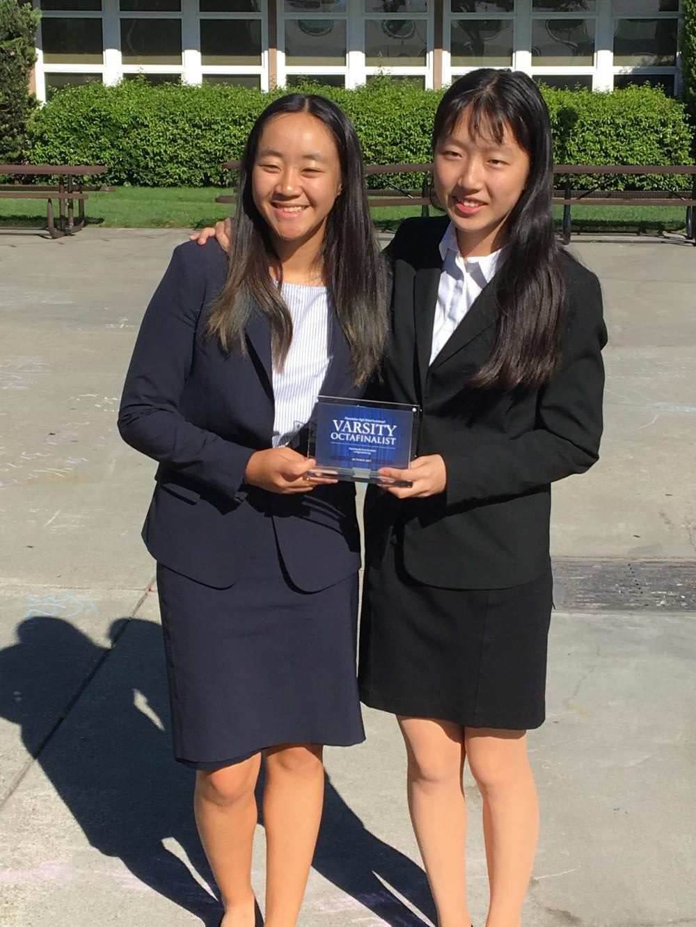 Public forum team Amanda Cheung (10) and Annie Ma (10) pose with their varsity octofinalist award from the Presentation Invitational. Harker had 15 public forum teams competing in the tournament.