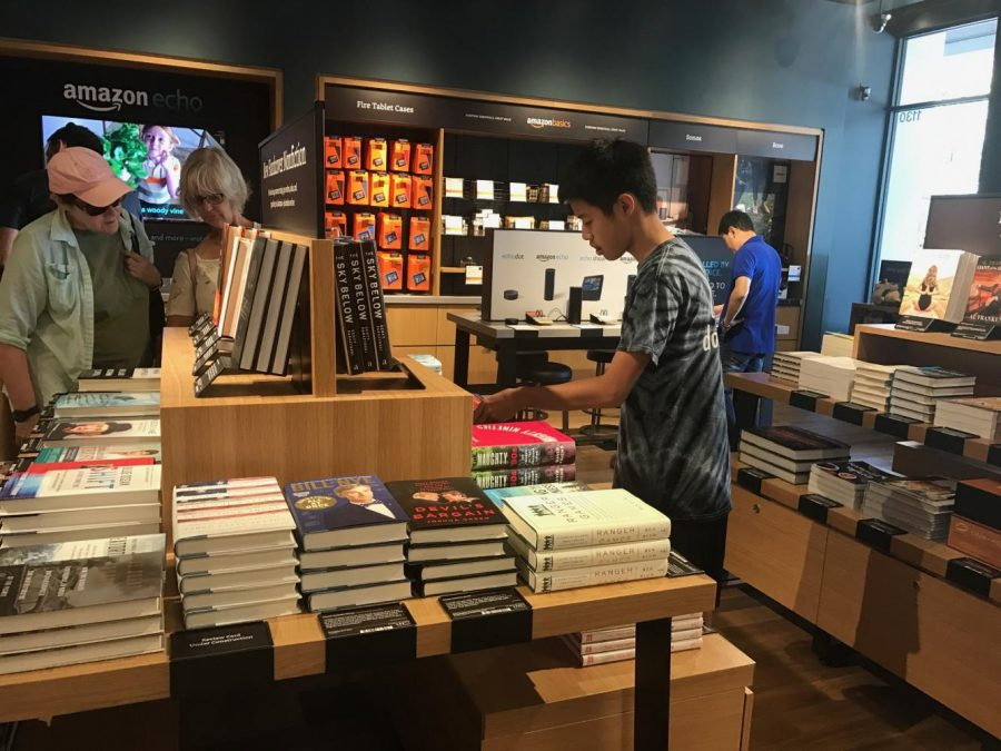 Evan Chang (10) browses through books at the bookstore. The bookstore at Santana Row opened in August.