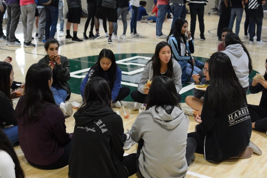 "Students gather in the auxiliary gym to eat lunch to avoid the unhealthy amount of participate matter in the air last week. ""You didn't want to be outside. When I drove north [around] San Mateo, it almost looked like the car was going underwater; the air was like a thick, dirty water,"" chemistry teacher Dr. David Casso, who lives in San Francisco, said."