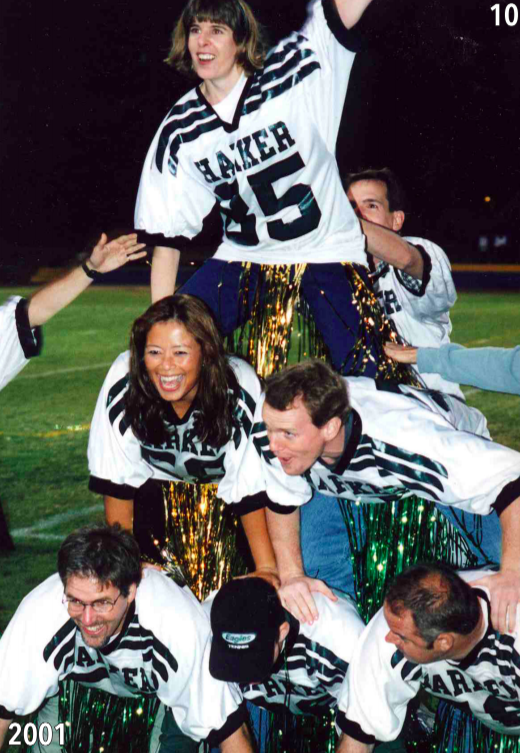 Upper school teachers form a human pyramid in celebration of homecoming in 2001.