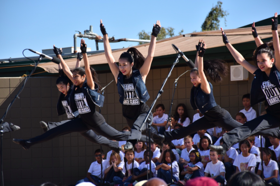The JV dance team performs a routine at a previous year's picnic. This year's picnic is themed Harker Hoedown.