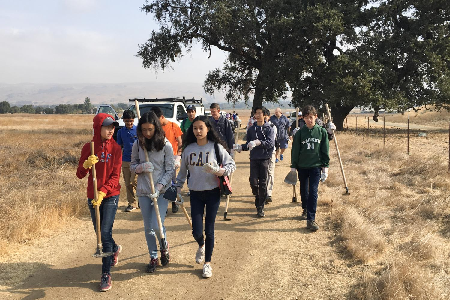 """A group of freshmen walk along a trail to their next trail repair site at the Coyote Valley Open Space Preserve. """"I'm most looking forward to… getting the opportunity to see my advisees get closer together. [If] we get out there and put in some sweat and some elbow grease into this project, I can't imagine something that would make us bond more closely together,"""