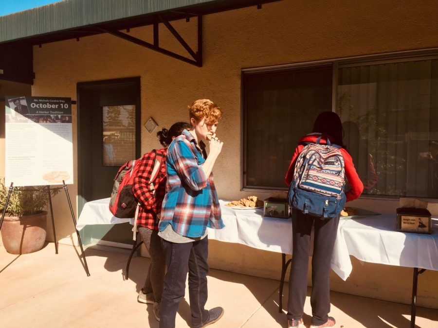 Students enjoy a treat of chocolate chip cookies from a table outside the Main offices after todays school meeting. Another table of cookies was stationed near the Singh Aquatics Center.