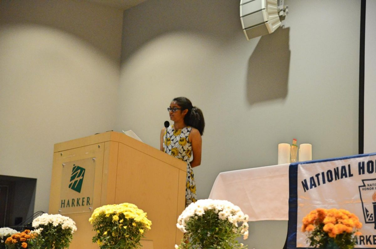 NHS vice president Tanvi Singh (12) reads off the names of this years 79 NHS inductees. Academic Dean Evan Barth handed induction certificates to the inductees after they walked across the stage.