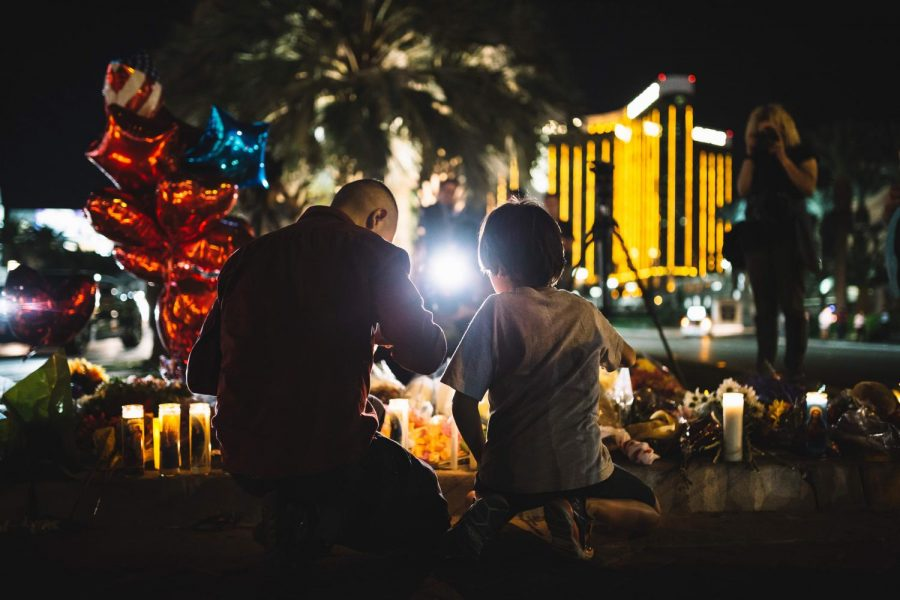 Across the site of the festival, people visit a makeshift memorial, one of several that have been set up in the last week in the wake of the shooting. Fifty-eight people were killed and at least 527 were injured.