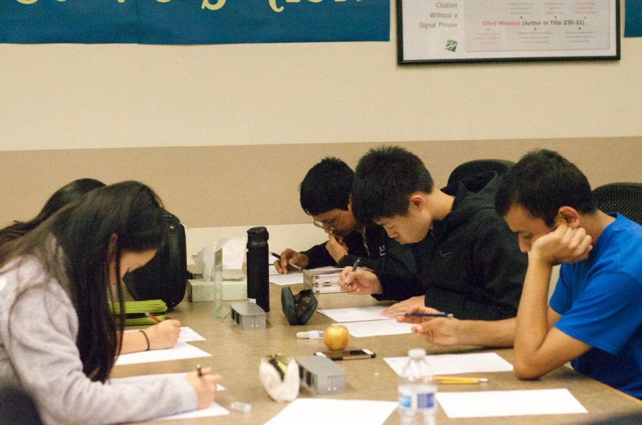 Math Club members work on practice problems for the Princeton University Mathematics Competition. The competition will take place on Nov. 18.