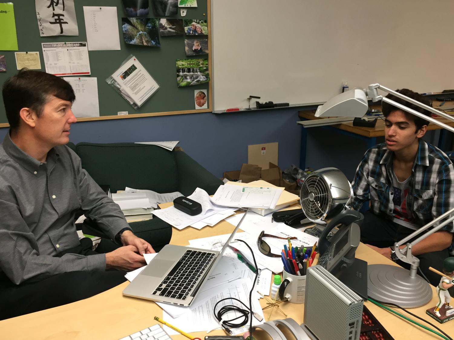 Alex Kumar (9) meets with his advisor Dr. Mark Brada for his one-on-one advisee review session today. Students signed up with their advisors for 10-minute time slots on Monday during advisory.