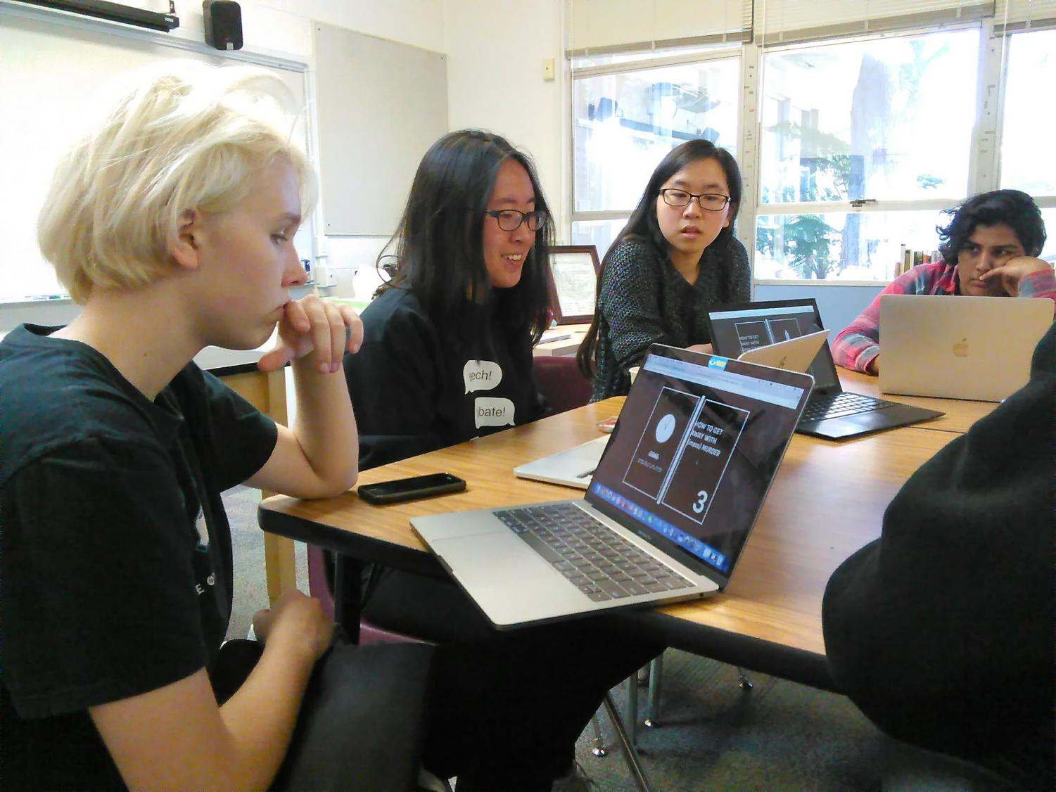 Elliot Kampmeier (9), Serena Lu (12), Gwyneth Chen (12) and Amla Rashingkar (10) review student work during one of HELM's workshops this week. HELM members also sold boba tea outside Manzanita on Tuesday, Wednesday and Friday for $5 each.