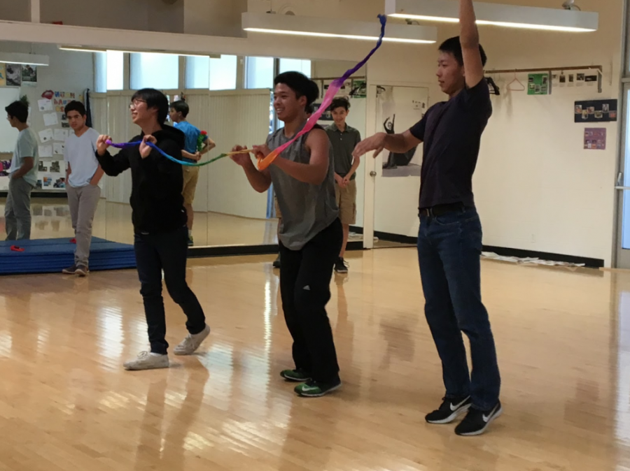 Dancers practice their routine with different props. The Dance Production will take place on Jan. 26 through Jan. 27.