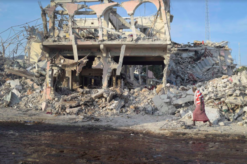 A Somali walks in front of the rubble of a building due to the Oct. 14 bombing in Mogadishu. Somali president Mohamed Abdullahi declared three days of national mourning for the bombing.