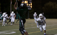 Floyd Gordon (12) catches a pass to score a touchdown. So far, the varsity football team is undefeated in their season.