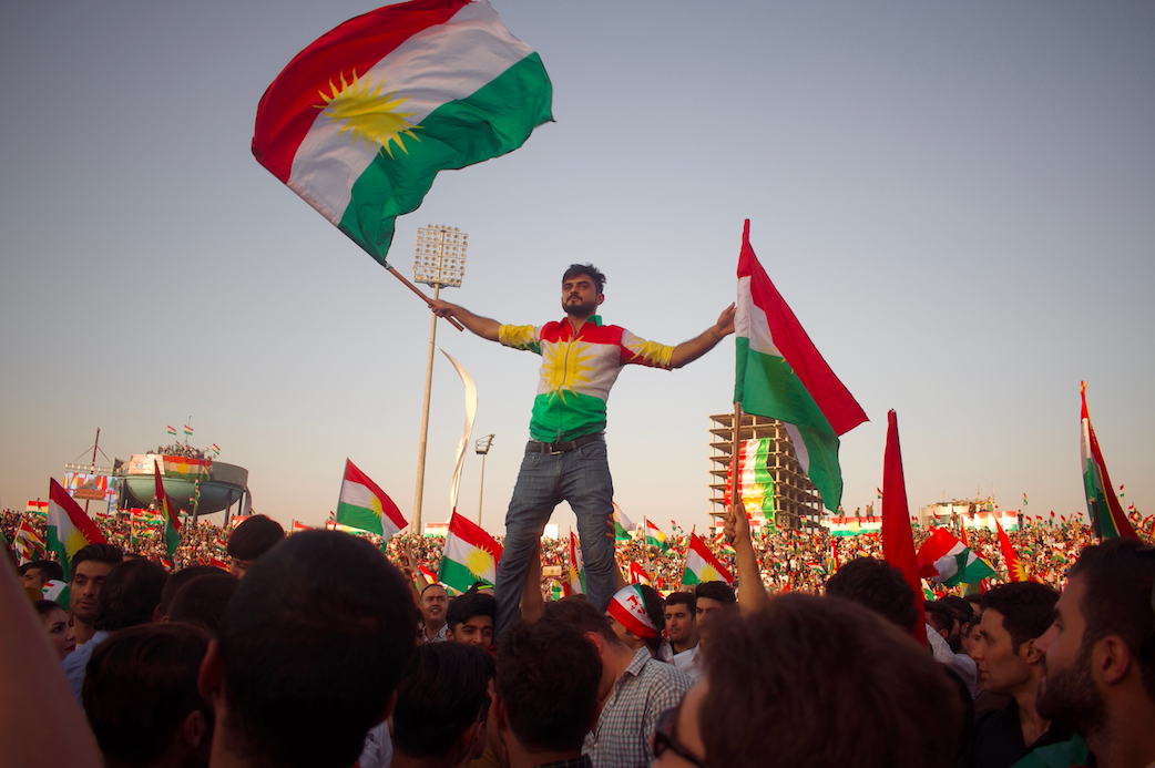 A man waves a Kurdish flag at a pro-Kurdistan independence rally shortly after the referendum in the city of Erbil, the capital of the Kurdistan region of Iraq. More than 92 percent of the three million voters opted for independence.