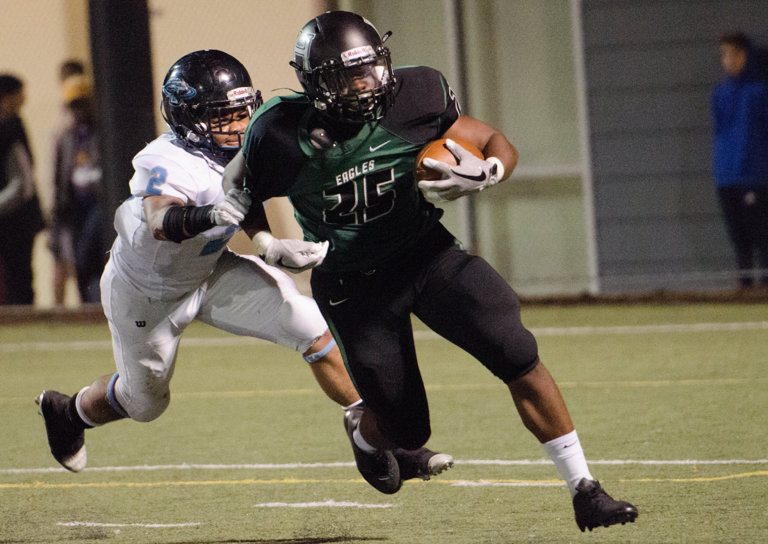 Aaron Smith (11) attempts to outrun a Hercules player. The football team ended the season with eleven wins and one loss.