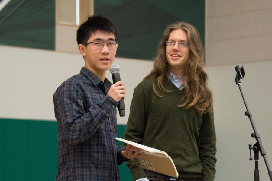 Linguistics Club representatives Derek Yen (12) and Andy Semenza (12) encourage students to sign up for the North American Computational Linguistics Olympiad (NACLO). Linguistics Club helped students prepare for the NACLO by offering presentations and practice problems.