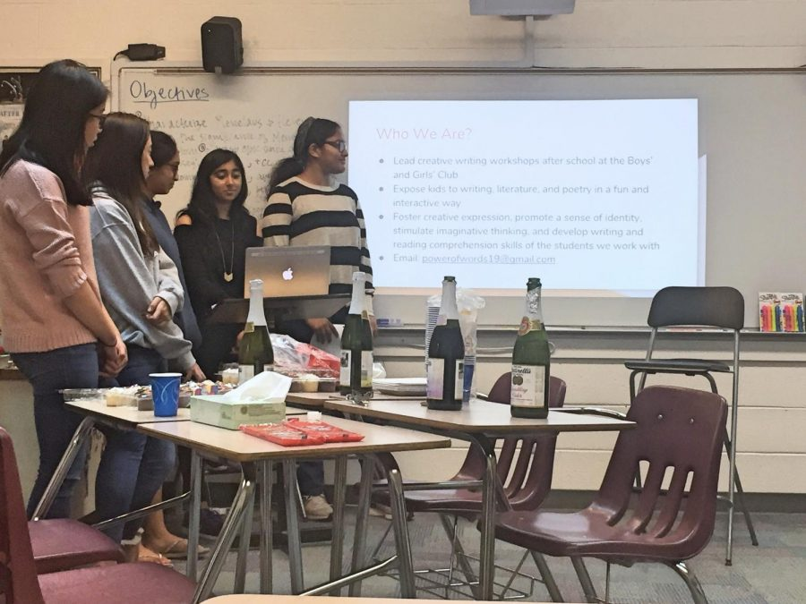 Power of Words (POW) secretary Gloria Zhang (10), PR officer Stephanie Xiao (11), treasurer Ashna Reddy (10) and co-presidents Riya Singh (11) Prameela Kottapalli (11) give a presentation introducing their club during the haiku-writing workshop. POW members also sold pearl milk tea from Teaspoon and popcorn from Popcornopolis this week for their club week.