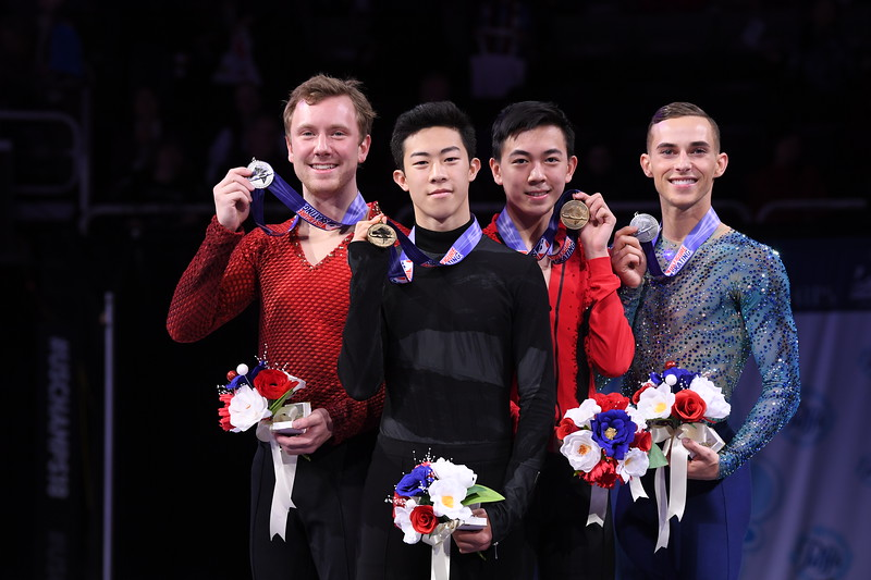 Senior men's singles division competitors Ross Miner, Nathan Chen, Vincent Zhou and Adam Rippon pose with their medals from the competition. Chen, Rippon and Zhou will be representing the U.S. at the 2018 Winter Olympics in Pyeongchang, South Korea.