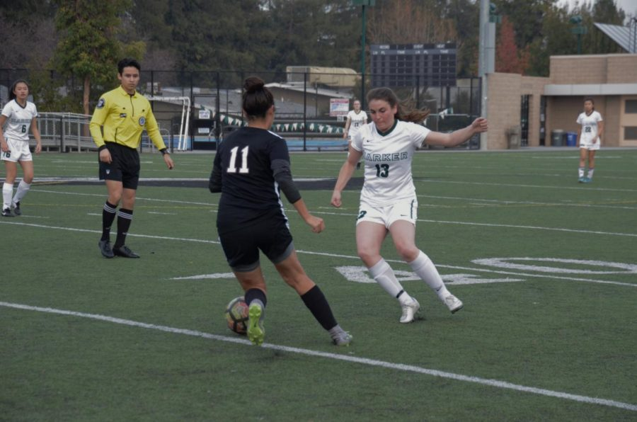 Cameron Zell (11) looks to steal the ball from an Eastside College Preparatory defender. The girls won 3-0, marking their first game and win of the season.