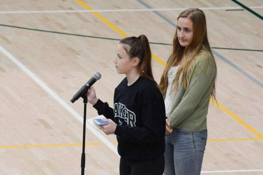 Members of Amnesty International Lauren Napier (12) and Isabella Spradlin (12) share details about the organization's club week next week. The club will be selling donuts and bagels before school on Jan. 23 and Jan. 25 as well as baked goods all week during lunch.