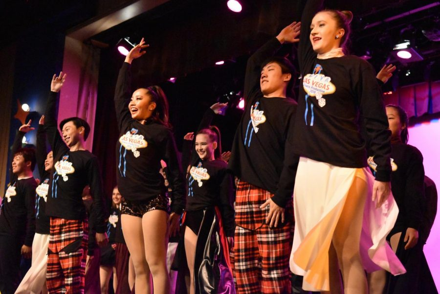 The+seniors+bow+at+the+end+of+their+finale+routine.+Themed+%22Viva+Las+Vegas%2C%22+this+year%27s+show+featured+approximately+150+dancers+in+23+dances.