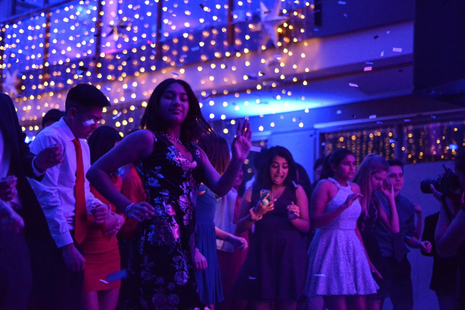 Sana Pandey (10) does the cha-cha to a mix of music from the DJ. Winter Ball took place on Jan. 20 in the Nichols Atrium.