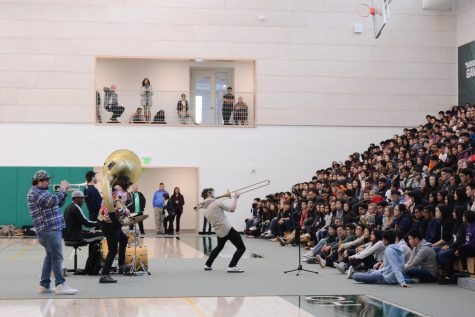 Brass band performs for upper school students and faculty