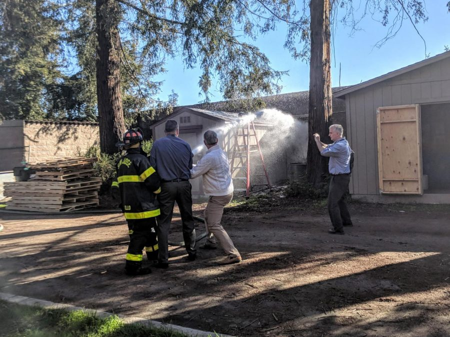 Head of School Brian Yager and Assistant Head of School for Student Affairs Greg Lawson assist the San Jose Fire Department put out fires behind Nichols. Students and teachers were evacuated to Davis Field after a small fire broke out on I-280.