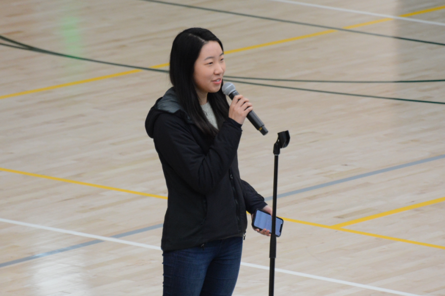TALON managing and business editor Sharon Yan (12) announces that a free yearbook lottery will take place at each grade's next class meeting. One member from each class will receive a free yearbook.