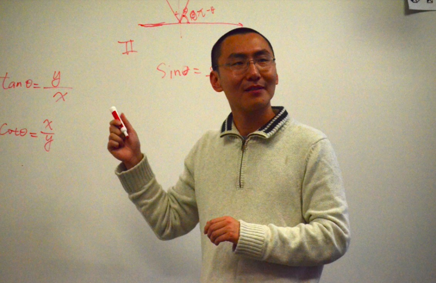 Shi delivers a lecture to his precalculus class.