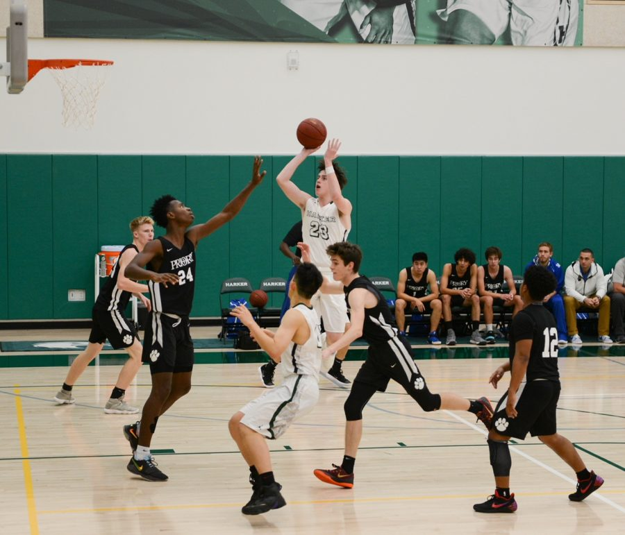 Jack Connors (10) attempts a shot over the hands of a Priory defender.  During this league game, Harker beat Priory 73-62.