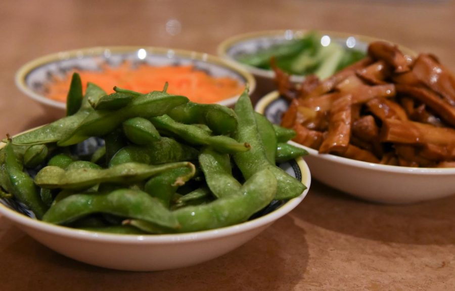 A lunch prep for a vegetarian meal consists of stir fry carrots, bamboo shoots, tofu, cucumbers and boiled edamame. Some Buddhists choose to eat only vegetarian foods on the first and 15th days of the Chinese lunar calendar.