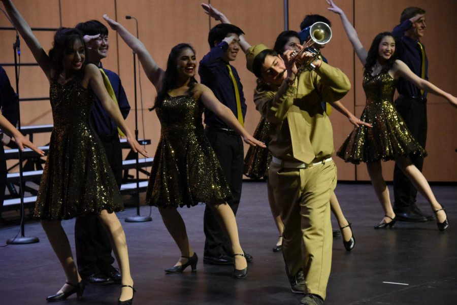 """Seniors Anika Banga, Sameep Mangat and Markus Wong and sophomore Kenya Aridomi dance to """"Boogie Woogie Bugle Boy."""" Downbeat was one of four upper school vocal groups performing in United Voices."""