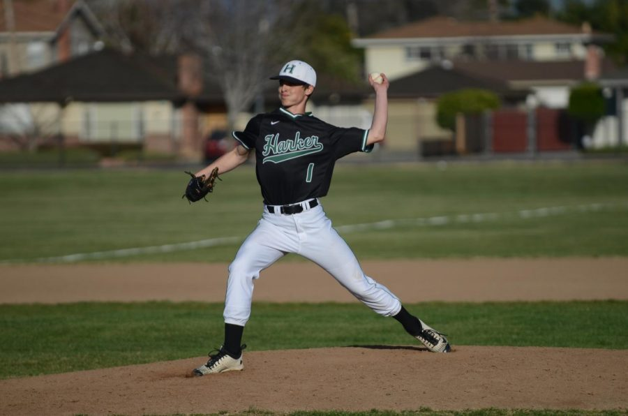 Anthony+Meissner+%2811%29+pitches+against+Prospect+High+School.+The+baseball+team+won+3-1.+