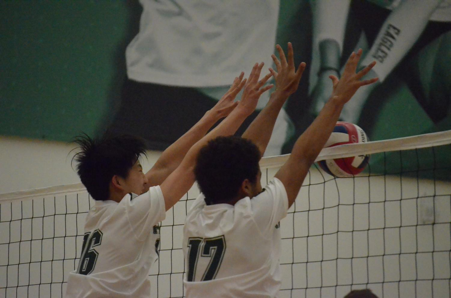Freshmen Billy Fan and Brian Pinkston block a ball against Mountain View High School. The varsity boys team beat Mountain View in four sets.