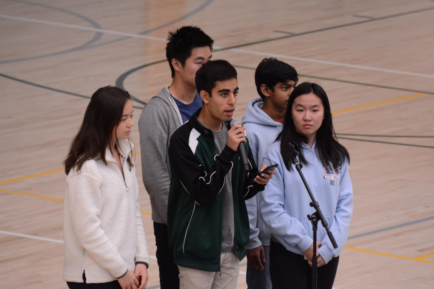 Student council members  Alycia Cary (11), David Wen (12), Avi Gulati (10), Akshay Manglik (9) and Kat Zhang (11) announce details about the upper school's upcoming support and advocacy initiatives in response to the recent Marjory Stoneman Douglas (MSD) shooting. Among these efforts include an optional vigil in the athletics center this Wednesday and a gun debate and town hall at 3:15 p.m. in Nichols Auditorium on March 23.