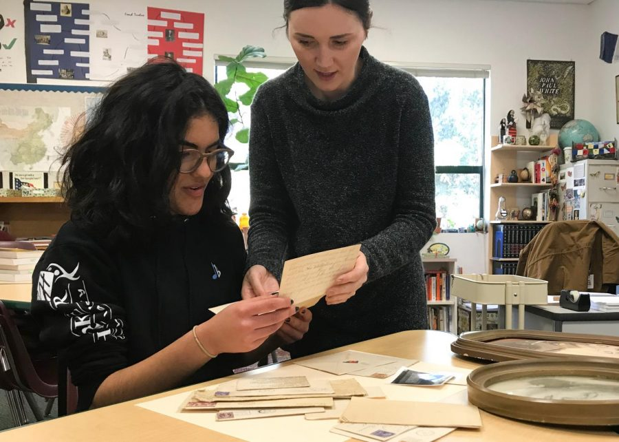 History Club advisor Roxana Pianko helps history club co-president Aryana Far (11) archive supplies from the trunk of World War II era supplies. The four trunks were brought to Pianko from Romania to the U.S. by a friend, who bought them at an auction.