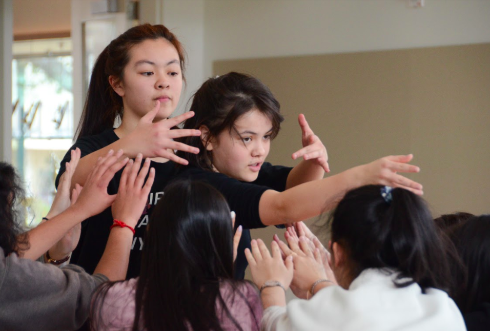 Sophomores Kaidi Dai and Sara Lynn Sullivan exude energy at a rehearsal for the Korean pop, or K-pop, dance routine.