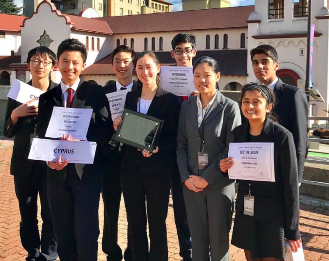 Harker BMUN competitors Jerry Su (11), Michael Eng (9), Andrew Lu (9), Amy Dunphy (12), Logan Bhamidipaty (11), Helen Yang (11), Sriya Prathuri (10) and Jai Bahri (10) posed with their awards after the conference. Inviting over 115 schools and 2,000 delegates to participate in three days of competitive events at this year's conference, BMUN aims to spread awareness of international issues and the spirit of diplomacy through U.N. simulations as well as develop public speaking and policy debate skills in high school students.