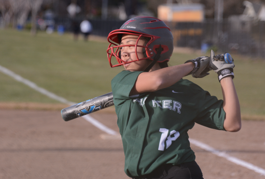 Junior Taylor Lam follows through after a swing against Notre Dame. Softball played all their home games at the Blackford campus.