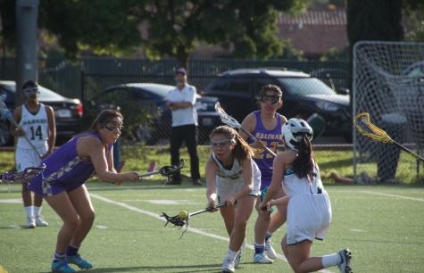Varsity girls lacrosse wins home game against Newark