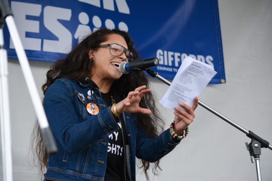 Poet and educator Asha Sudra performs slam poetry at the March for Our Lives rally.
