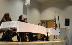 Gun debate participants Andy Semenza (12), Serena Lu (12), Sophia Gottfried (9), Sachin Shah (10), Edgar Lin (12) and Jason Huang (11) take audience questions about their speeches. Today's event in Nichols Auditorium was moderated by Aliesa Bahri (12), Dolan Dworak (12), Sahana Srinivasan (12) and Jai Bahri (10).