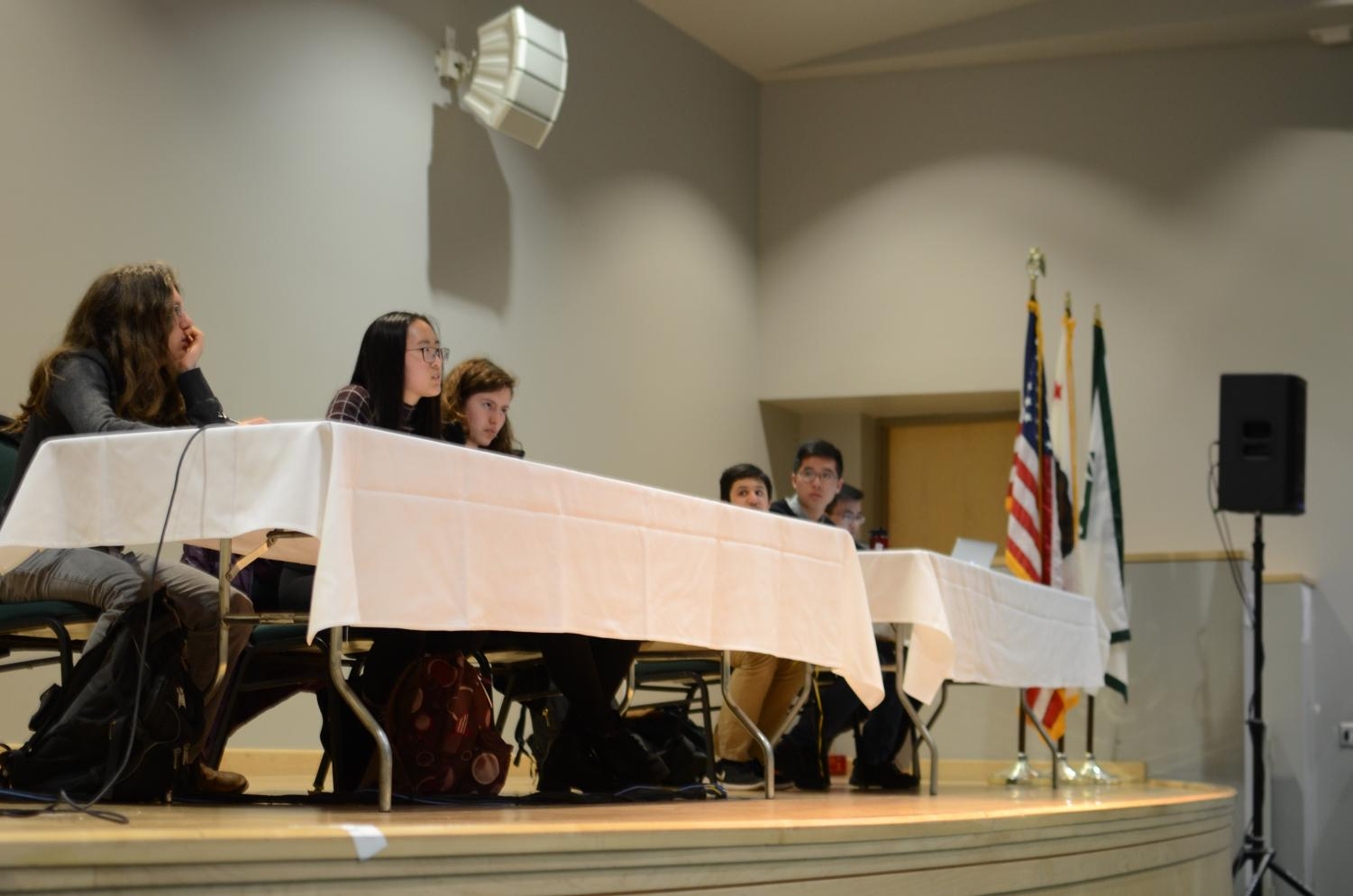 Gun debate participants Andy Semenza (12), Serena Lu (12), Sophia Gottfried (9), Sachin Shah (10), Edgar Lin (12) and Jason Huang (11) take audience questions about their speeches. Today's event in Nichols Auditorium was moderated by Aliesa Bahri (12), Dolan Dworak (12), Sahana Srinivasan (12) and Jai Bahri (10).