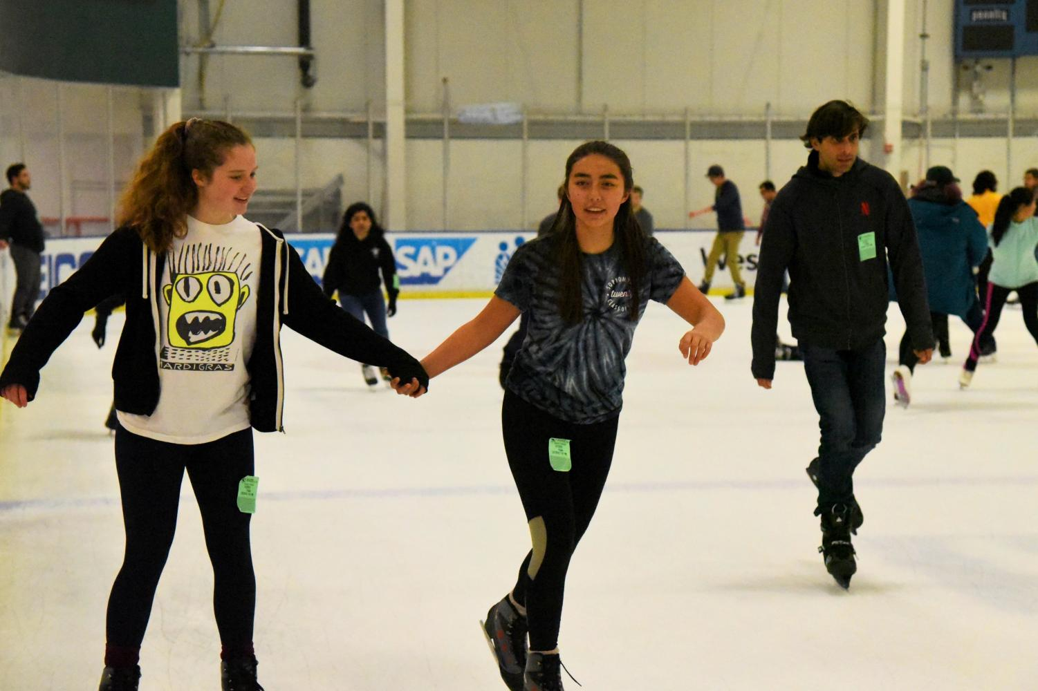 Charlotte Blanc (10) and Cas Ruedy (10) skate around the Solar4America Ice rink together. Trip attendees had the option of taking the bus from the upper school at 7 p.m. and returning to campus at 9:30 p.m. or driving to the venue separately.