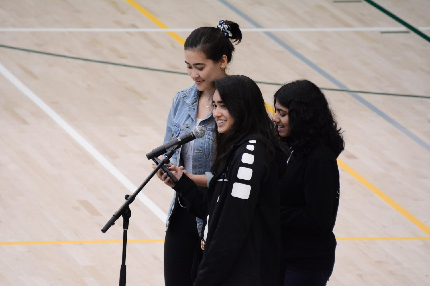 Green Team members Karen Krause (11), Satchi Thockchom (12) and Anvi Banga (10) announce the results of this year's Bay Area High Schools Challenge.