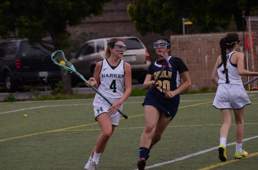 Sophomore Piper White cradles the ball as she evades an opposing player. The eagles won the game 13-3.