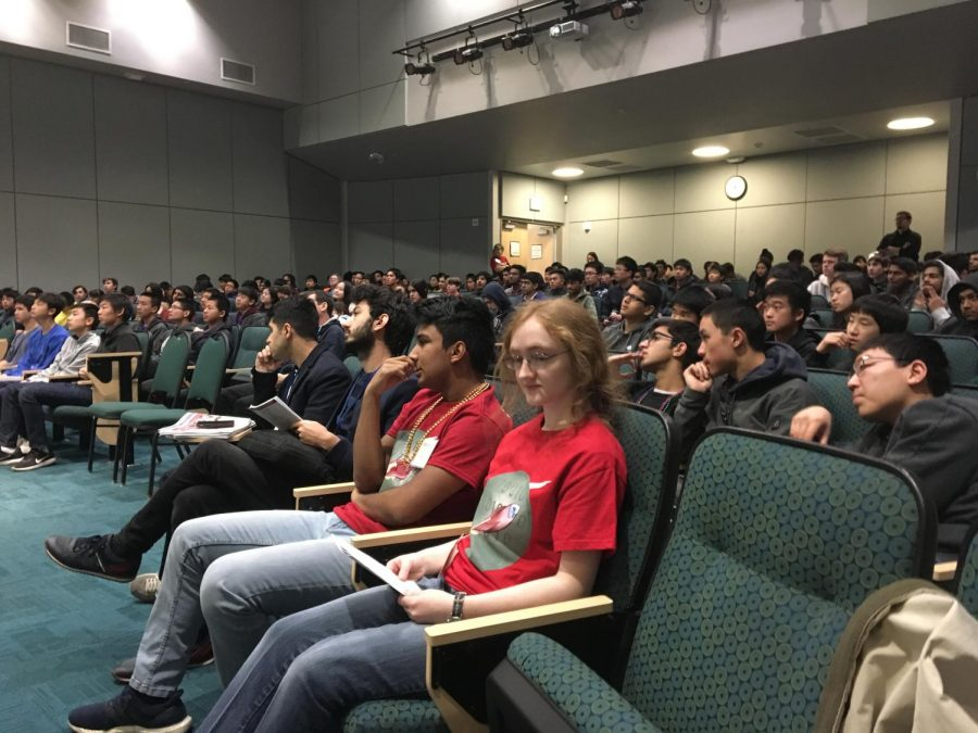 Programming club officers Rakesh Nori (10) and Alexandra Michael (12) sit in the audience before a talk. The club hosted talks and also featured a keynote speaker.