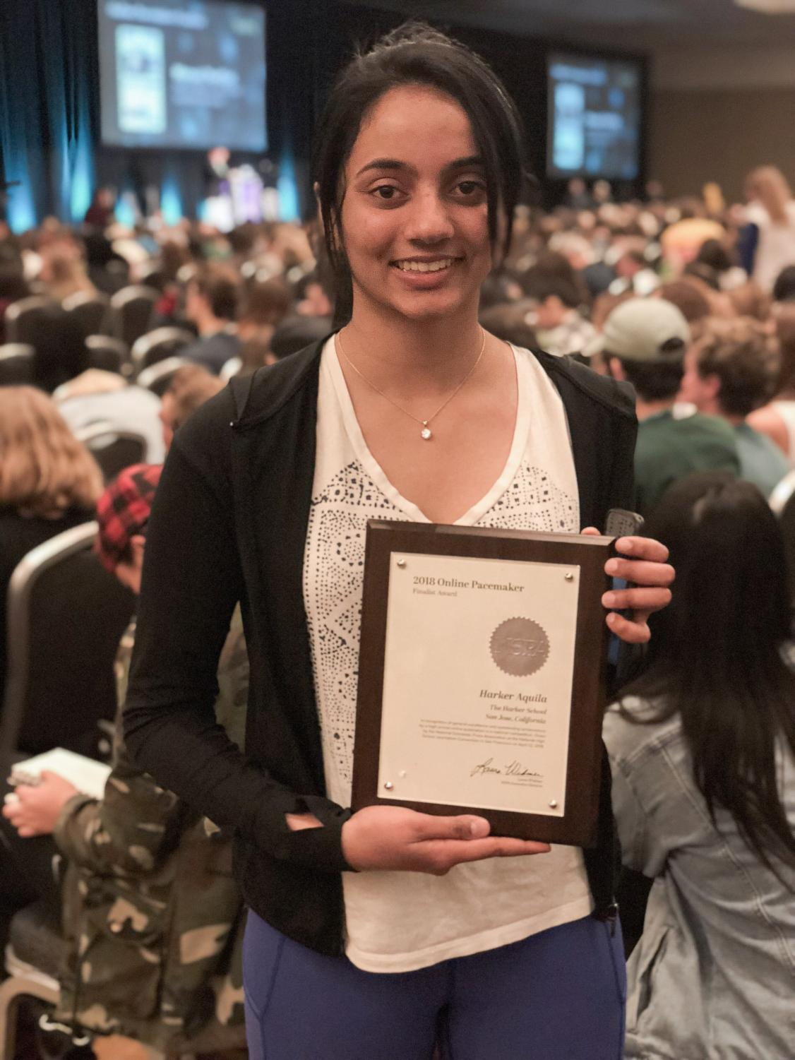 Harker Aquila editor-in-chief Meena Gudapati (12) holds the publications Pacemaker finalist award. Print publication the Winged Post placed fifth in the event's Best of Show competition.